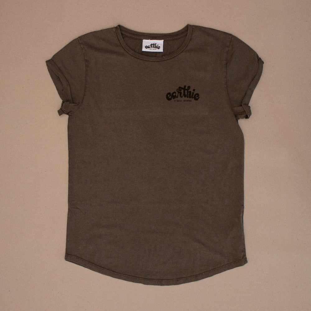 Front of a Womens Rolled Sleeve Tee in Stone Wash Grey, showing the back of the shirt which has a small black Earthie logo printed across the Front right.