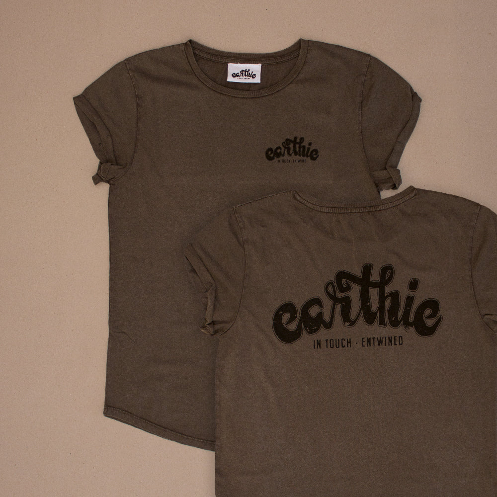 Two Womens Rolled Sleeve Tee in Stone Wash Grey grouped together, one showing the front of the garment with a small black Earthie logo printed on the front left chest position, the other showing the back of the shirt which has a large black Earthie logo printed across the shoulders.