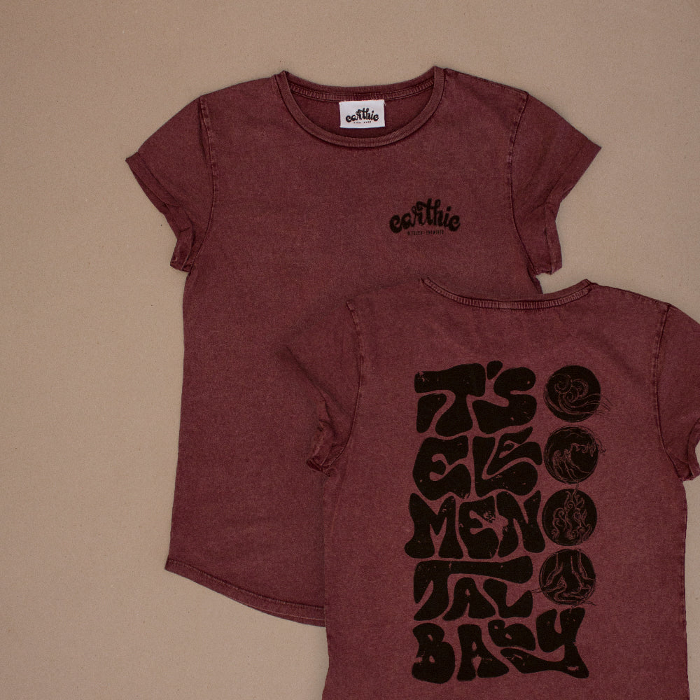 Two Elemental Womens Rolled Sleeve Tee in Stone Wash Burgundy One Print On with small Earthie logo front right in black other design on back lettering reading It`s Elemental Baby in black with 4 Elements design