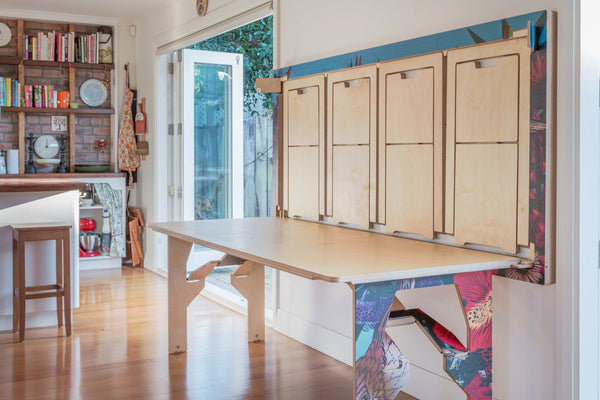 fold out table that doubles as artwork