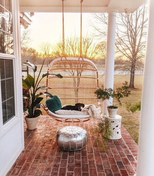 porch swing with a dog on it