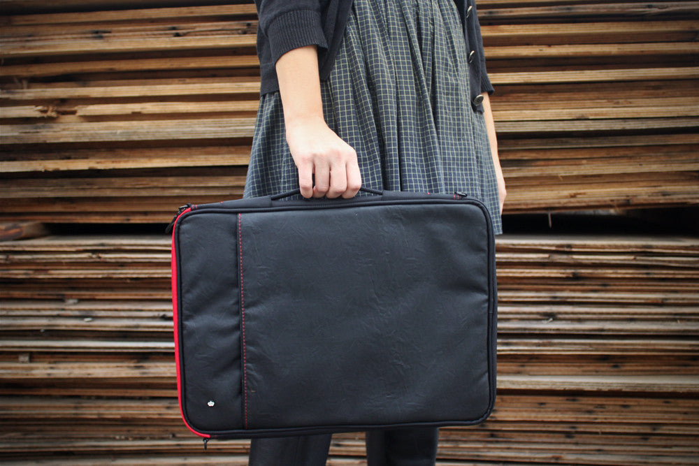 THE PRIMARY COLLECTION | STUFF SLEEVE | FAUX COW | black red