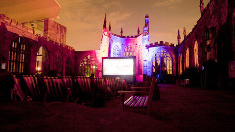Outdoor cinema experience with a cocktail.