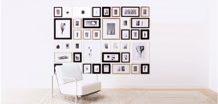 once the hooks are on the wall you can arrange rearrange frames and colors to your hearts content