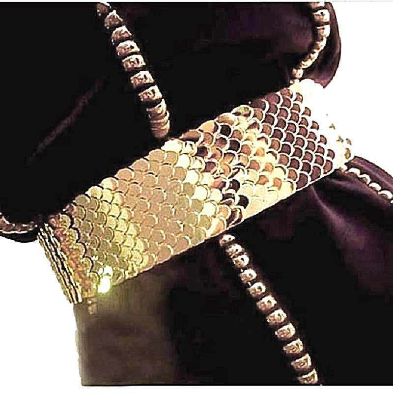 woman wearing gold snake belt