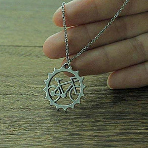 hand holding bicycle pendant and chain