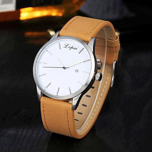 brown leather band white watch face analog watch