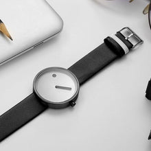 Load image into Gallery viewer, line and dot wristwatch lying face up on table top