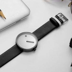 line and dot wristwatch lying face up on table top