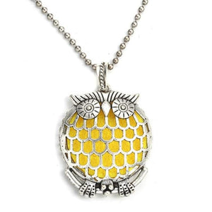 intricate owl with large grated tummy diffuser necklace
