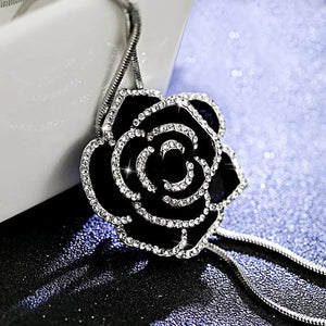 side view of black rose pendant