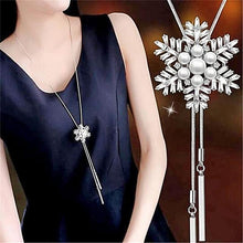 Load image into Gallery viewer, woman wearing snowflake pendant