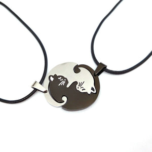 one silver and one bronze cat friendship necklaces