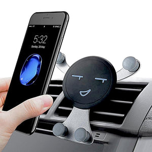 hand holding cell phone with emoji phone holder in the car
