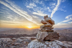 rocks balanced on a mountain top