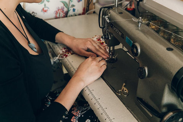 Designer Ayten Roberts sewing in her lingerie boutique and atelier