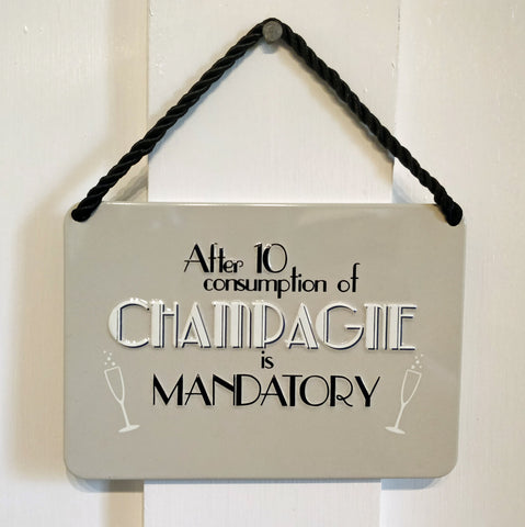 'After 10 consumption of Champagne is Mandatory' Vintage-style metal plaque