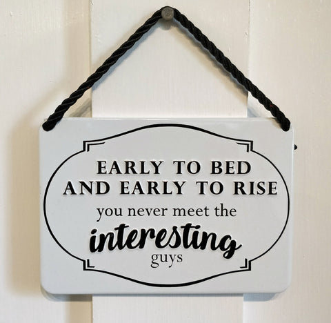 'Early To Bed And Early To Rise you never meet the interesting guys' Vintage-style metal plaque