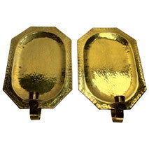 A pair of Hammered Brass Wall Plaque Candle holders