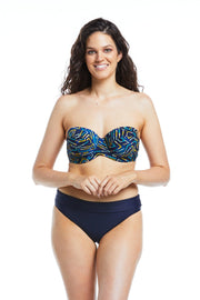 Emma Co Founder wearing navy balconette bikini top and bottoms 10DD