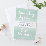 Personalised wedding save the date in Welsh and English by Draenog Design - Cerdyn cadw dyddiad y briodas dwyieithog - Gwenllian ac Aled