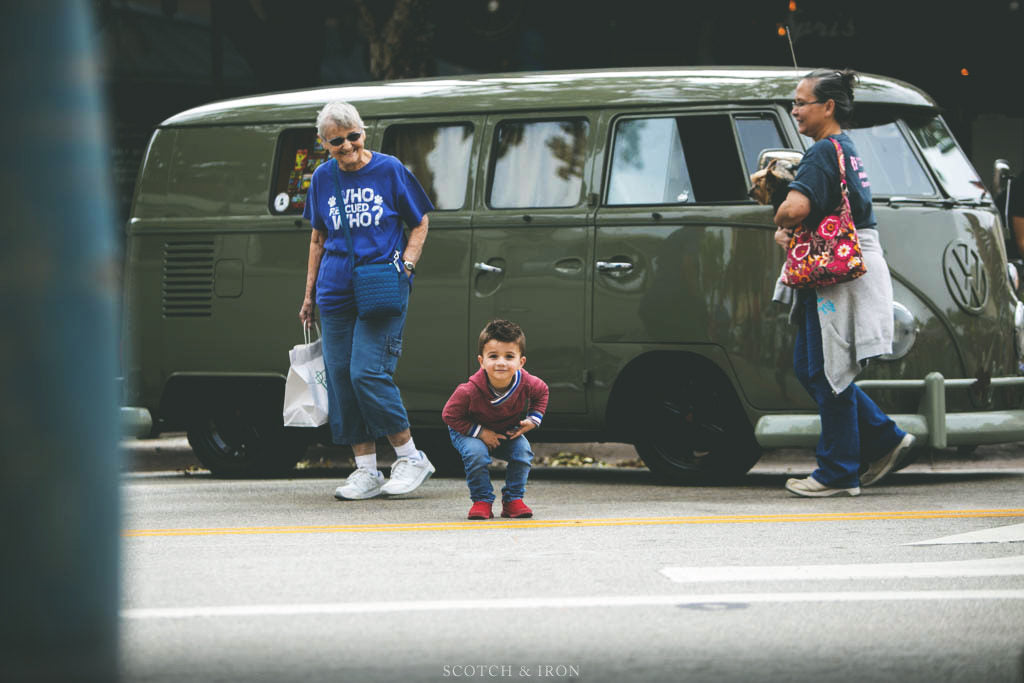 kid in front of green vw bus
