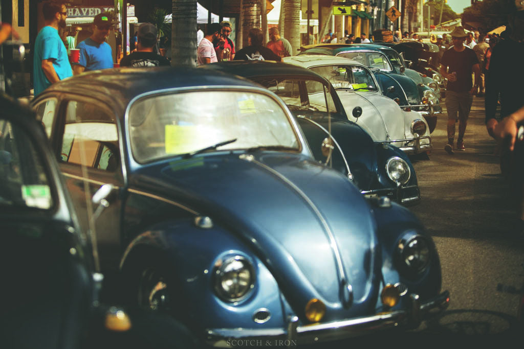 long row of VW beetles in miami show