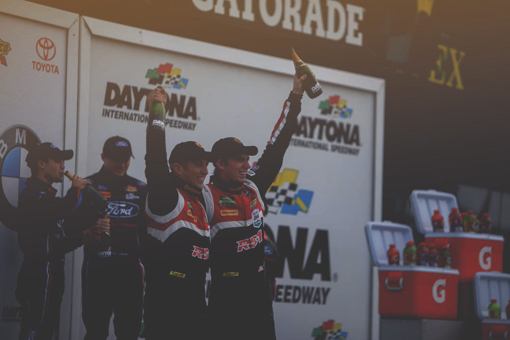 Spencer Pumpelly and Dillon on the podium at Daytona