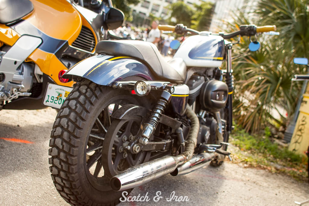 harley sportster with dirt tires blue and yellow paint