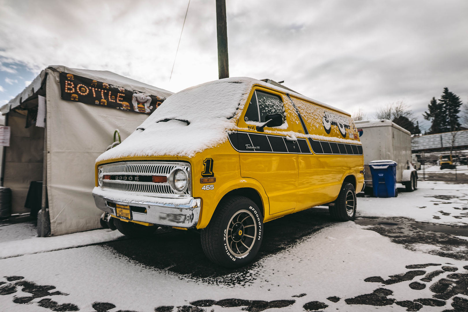 custom yellow yamaha themed dodge van at motorcycle show portland