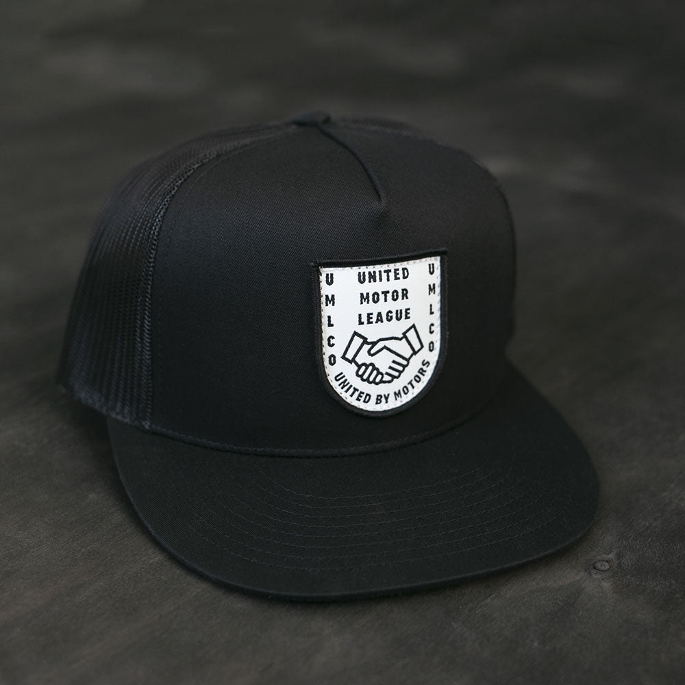 umlco gentlemans badge trucker hat
