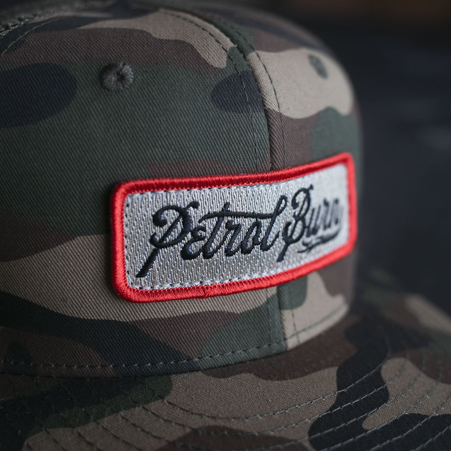 Burn Logo Camo Trucker