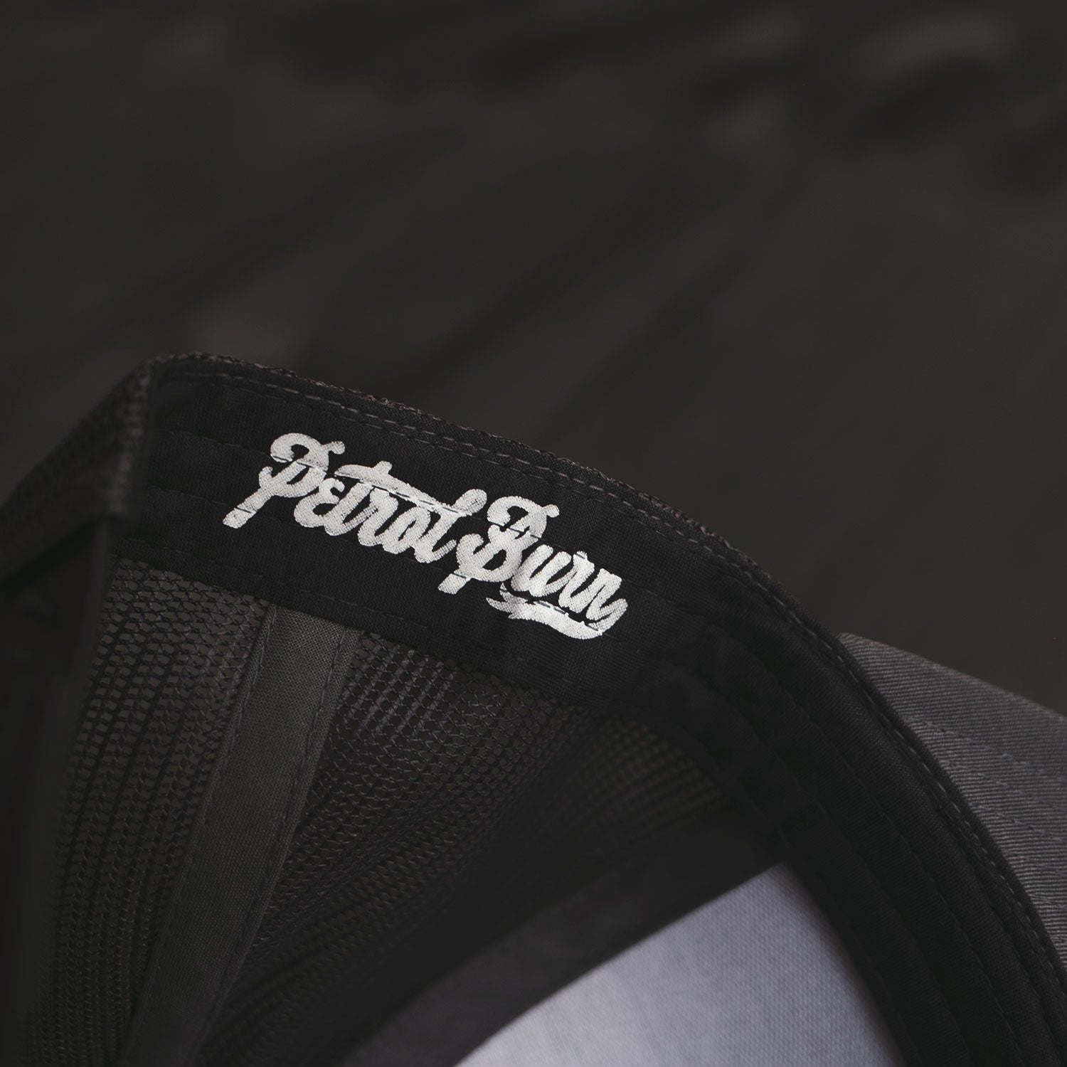 18-Year Logo Black Trucker