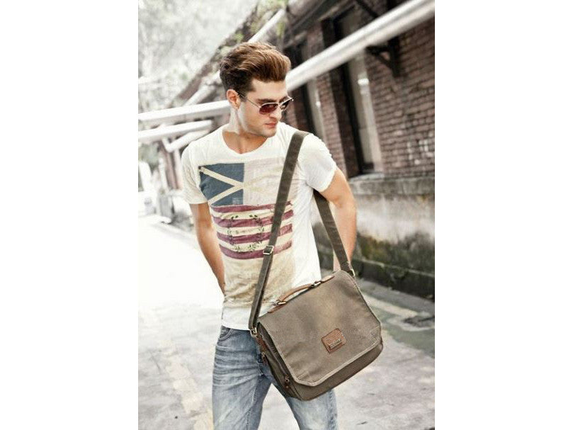 stylish guy wearing a distressed messenger bag by Serbags