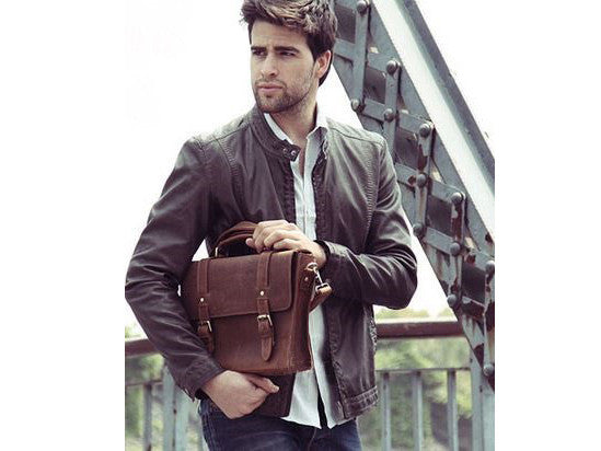 Stylish man sporting a signature brown leather messenger bag by SerBags