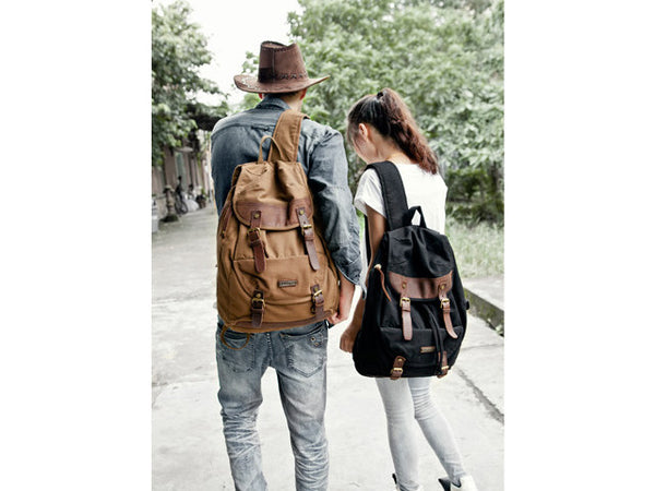 Couple sporting the Serbags canvas & leather backpacks