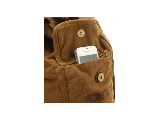 Side pocket details for brown canvas and leather rucksack