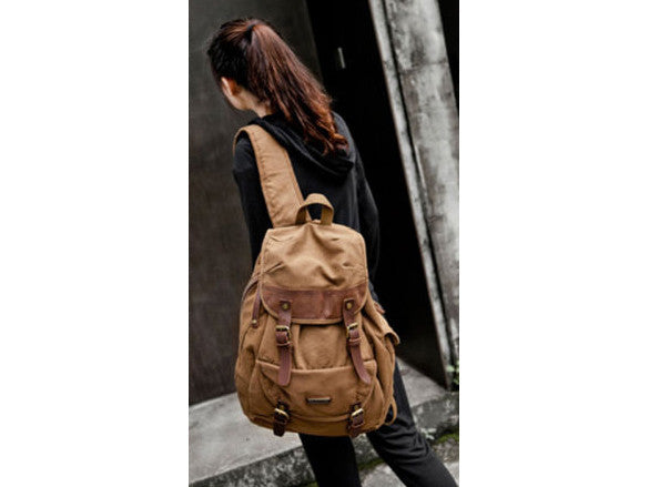 Woman wearing the Serbags brown canvas and leather rucksack