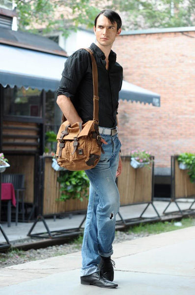 man wearing brown military style messenger bag with leather straps by Serbags