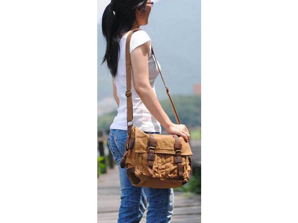 girl wearing unisex brown canvas military style messenger bag