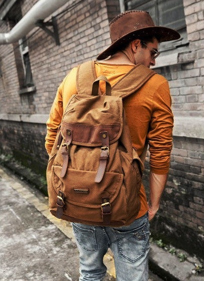 Stylish man sporting the brown canvas and leather rucksack by Serbags