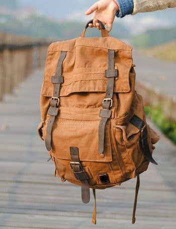 Front view of the brown Serbags canvas travel backpack