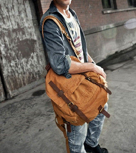 Man wearing the brown canvas travel backpack by Serbags