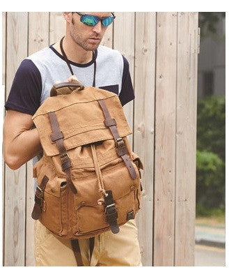 brown Serbags canvas travel backpack worn by stylish man
