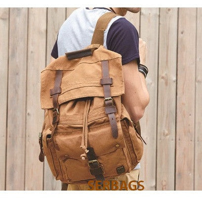 Man wearing the brown Serbags canvas travel backpack