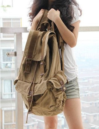 Woman sporting the light-brown Classic Canvas Rucksack Backpack by Serbags