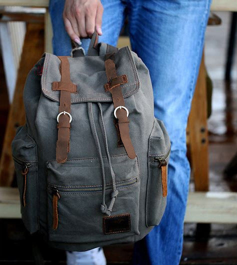 Woman wearing the gray casual canvas backpack with laptop compartment by Serbags