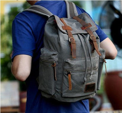 Man wearing the Serbags gray casual canvas backpack with laptop compartment
