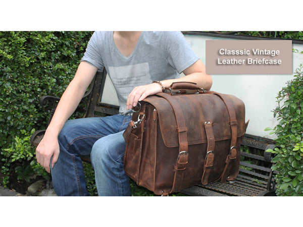 Man sitting next to his Selvaggio handmade leather briefcase & backpack