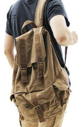 Man wearing the Serbags Classic Canvas Rucksack Backpack